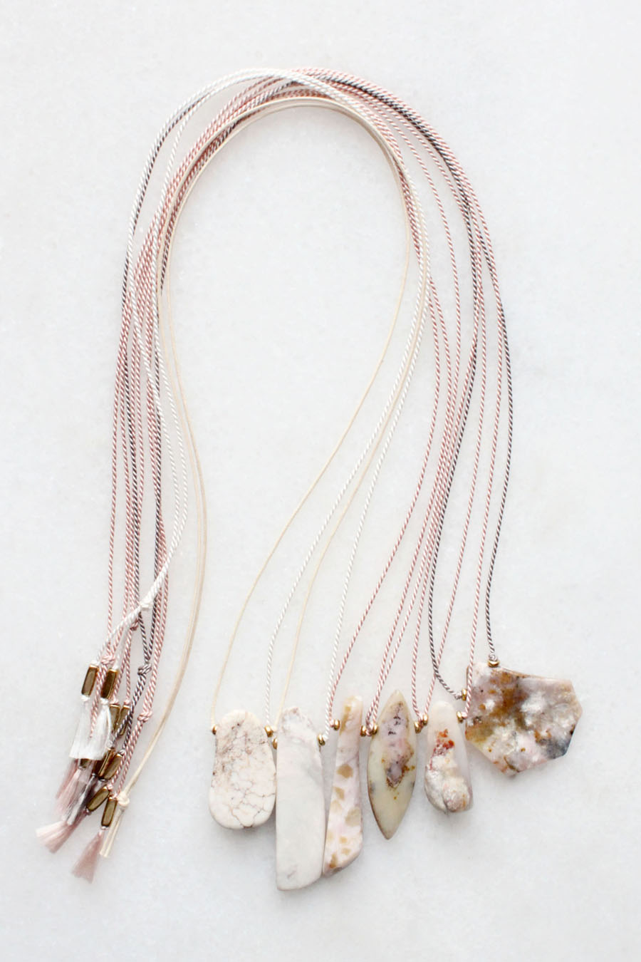 Silk and cotton necklaces with natural magnesite and pink opal